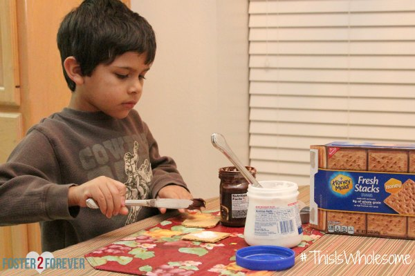 LilBit can make his own s'mores with Honey Maid graham crackers, marshmallow cream, and chocolate spread.